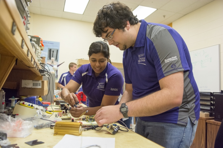 Connor Krause, and Tanzila Ahmed begin to test the electrical circuit.