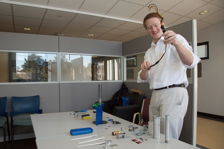 Team member Michael Wertz assembling the 2014 Northern Arizona University's team's turbine.