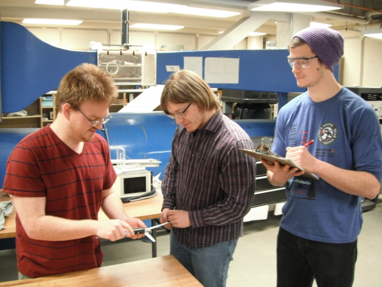 Members of Arctic Winds analyzing current blade technology. From left to right: Matthew Pacheco, Alex Mitchell, Dalton Newbrough.