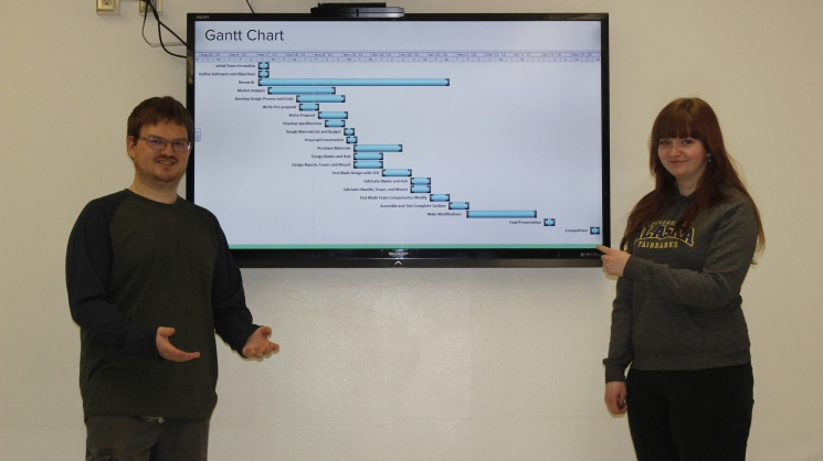 Members of Arctic Winds Aerodynamics and Structure sub team, Matthew Pacheo  and Jessica Garvin, present their project schedule. Planning is key for large projects to insure that all of the sub teams can work together to meet deadlines.