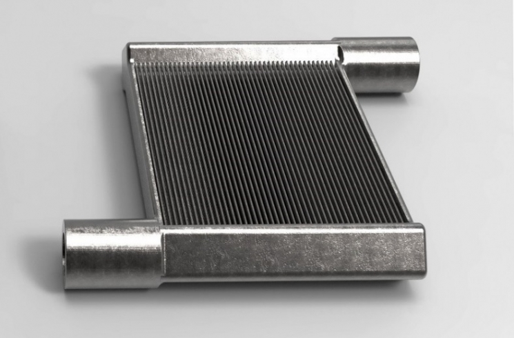 The University of Maryland used direct metal printing—a 3D printing technology—to manufacture a unique miniaturized air-to-refrigerant heat exchanger as a single, continuous piece. Image: University of Maryland, Center for Environmental Energy Engineering.