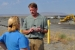 Hanford Federal Project Director Mark French explains the waste site remediation efforts taking place at the 618-10 Burial Ground to a member of the media.
