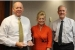 """EMCBC Director Jack Craig, left to right, EM Executive Assistant Jillian Carter, who is EM's Feds Feed Families representative, and Senior Advisor for Environmental Management David Huizenga pause for a photo Nov. 8. Craig holds the """"Teamwork Award"""" he and his staff received."""