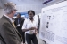 Benedict College student Faith Kibuye explains her researcher to SRNL Laboratory Director Dr. Terry Michalske