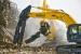 Excavators cut and move debris.