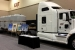 Three HalfPACT transportation packages on a Waste Isolation Pilot Plant (WIPP) truck are parked inside the exhibit hall at the 2013 Waste Management Conference. WIPP featured the exhibit as part of outreach to visitors at the annual gathering in Phoenix.