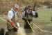 Oak Ridge scientists Kelly Roy, left, and Trent Jett collect fish samples in 2011 to support research on the impacts of the treatment in Tims Branch, a small stream at the Savannah River Site.