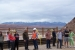 Students from the University of Utah contemplate the hillside geology at the rail load out area while Moab Federal Project Director Donald Metzler (in orange vest) addresses a question. The uranium mill tailings pile is behind and below the viewing area.