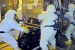 Workers separate highly contaminated glove boxes from their connection points in Hanford's Plutonium Finishing Plant.