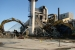 Workers demolish the 384 Building, known as the Power House and Heating Plant, in the north portion of the 300 Area.