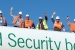 """Workers gather behind a """"Safety and Security begins with Me"""" banner at the Savannah River Site."""