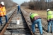 Employees with Swift & Staley Inc., a Paducah site small business contractor, repair a railroad on the site.