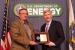 Deputy Secretary Daniel Poneman, right, presents the Secretary's Achievement Award to Richard Craun, representing the Idaho Operations Office.