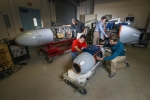 """At Sandia National Laboratories, researchers have developed pods that can survey and """"taste"""" radioactive particles without exposing a human crew to nuclear hazards. The three pods, when attached to aerial vehicles, can collect and analyze airborne radioactive particles to track and source gases that can identify a nuclear bomb's origins. Learn more about the <a href=""""http://share.sandia.gov/news/resources/news_releases/airborne_pods/"""" target=""""_blank"""">particulate-collection system</a>. 