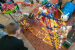 """Last week, Argonne National Laboratory hosted the 18th annual Rube Goldberg Machine Contest, which gathered nine high school teams in a competition to build a series of simples tasks, combining the principles of physics and engineering. By using common objects like marbles and bicycle parts, the students were assigned to build a machine that takes at least 20 steps to hammer a nail. In this photo, members of a Hoffman Estates High School team works on assembling a Toyland-themed Rube Goldberg machine. Check out more <a href=""""http://www.flickr.com/photos/argonne/sets/72157633023662385/with/8568153243/"""" target=""""_blank"""">photos of the competition's complex and colorful Rube Goldberg machines</a>. 