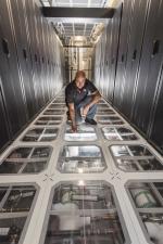 Sandia National Laboratories engineer David J. Martinez examines the cooling system at Sandia's supercomputing center. (Photo by Randy Montoya)