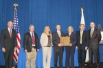EM employees were part of the Uranium-233 (U-233) Disposition Alternatives Analysis team. Members of the team are pictured here with Secretary Chu, second from right, after receiving an Achievement Award Thursday.