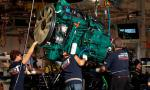 Workers at Volvo Trucks' New River Valley plant guide an engine into place. | Courtesy of Volvo Trucks