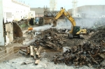 Heavy equipment demolishes the last part of the eastern third of the C-410 Feed Plant at the U.S. Department of Energy's Paducah Site. In October, DOE cleanup contractor LATA Kentucky reached a milestone of a million hours since mid-November 2010 without a lost workday case due to illness or injury.