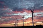 wind turbine blades at sunset