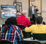 SRNS Solid Waste Management Director John Gilmour presents on nuclear waste management at the information pods at ATC.