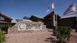 Through a U.S. Department of Energy grant, the Tonto Apache Tribe installed a 76.5-kilowatt photovoltaic system on their administration building to reduce building energy use. Photo by Deb Lastowka, National Renewable Energy Laboratory