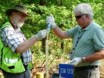 Savannah River National Laboratory Engineering Specialist Keith Hyde, right, and Savannah River Nuclear Solutions Geologist Bob Craig use a disposable Hydrasleeve sampler to monitor groundwater as part of efforts to meet regulatory requirements at the Savannah River Site.