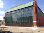 A historic hangar at the Wright-Patterson Air Force Base in Ohio was salvaged and restored with window films to reduce solar heat gain, occupancy sensors to control interior lighting, and daylight sensors to maximize energy savings and enhance productivity.