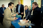 Oak Ridge National Lab's Ayyoub Momen demonstrates ultrasonic clothes dryer technology for David Danielson, Assistant Secretary for Energy Efficiency and Renewable Energy (EERE)