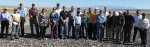 The visitors pose for a group photo on the disposal cell cover at the Crescent Junction site.