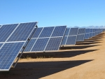 A long row of PV panels in the desert.