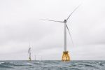Offshore wind turbines in heavy seas.