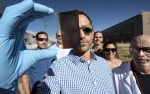NREL researchers developed a switchable photovoltaic window that splits between transparent and opaque states.