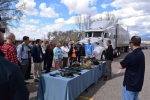 An OST convoy commander explains equipment used by Federal Agents during convoy operations for participants in the NNSA 1st Year program session in Albuquerque.