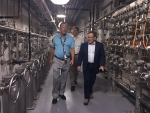 DOE-Savannah River Facility Representative Steve Stamper (left) walks with Deputy Energy Secretary Dan Brouillette through the Salt Waste Processing Facility.