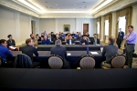 Panel participants engage students from various universities.