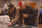 Area residents examine a tabletop model of the Portsmouth Site at one of the recent community open houses conducted by EM and stakeholder organizations.