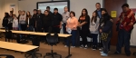 Fluor Idaho President Fred Hughes and Communications Director Ann Riedesel (center) gather with the students from Fort Hall Junior and Senior High School after the career opportunity class organized by the Foundation for Indigenous Education, Leadership D