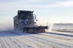 An MSA employee removes snow from Hanford roads.