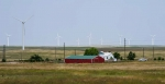 Farm with a wind turbine.