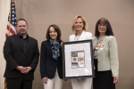 Consortia program directors present NNSA Administrator Ms. Lisa E. Gordon-Hagerty with a plaque signed by students for NNSA's support of university research and education programs in nuclear security and nonproliferation.
