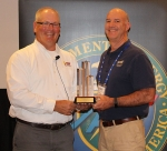 Savannah River Remediation Environmental, Safety, and Health Programs Manager Kevin Smith, right, accepts the Voluntary Protection Program Legacy of Stars Award from DOE Office of Worker Safety and Health Assistance Director Brad Davy.