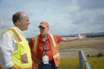 EM Portsmouth/Paducah Project Office's Johnny Reising, right, discusses progress on construction of the Portsmouth Site's Onsite Waste Disposal Facility with Under Secretary for Science Paul Dabbar from the facility's observation tower.