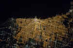 an arial view of a city at night showing the night lights.