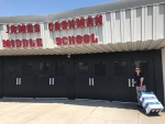 Nevada Site-Specific Advisory Board Administrator Barb Ulmer delivers the EM Nevada Program's learning materials to James Cashman Middle School in Las Vegas.
