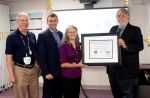 Oak Ridge officials stand with the DOE Voluntary Protection Program Star Site Award.