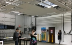 Photo of mockup space with high-efficacy LED luminaires installed in the ceiling.