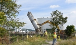 Crews began demolishing Building K-1232 by knocking down a 74-foot silo that was part of the structure.