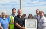 Portsmouth Mission Alliance United Steelworkers (USW) presents the latest Voluntary Protection Program (VPP) certificate at the Portsmouth Site flagpole where the VPP STAR flag flies for the eighth consecutive year.