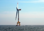 Photo of a wind turbine at sea.